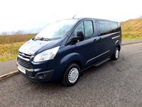Ford Transit Tourneo LEZ Compliant 9 Seater Wheelchair Accessible Minibus in Blazer Blue with Options for 6 Seats on Tracking Half Bulkhead System and Onboard Wheelchair Lift
